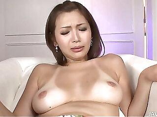 Mai Kuroki sucks a cock while her sweet pussy toyed